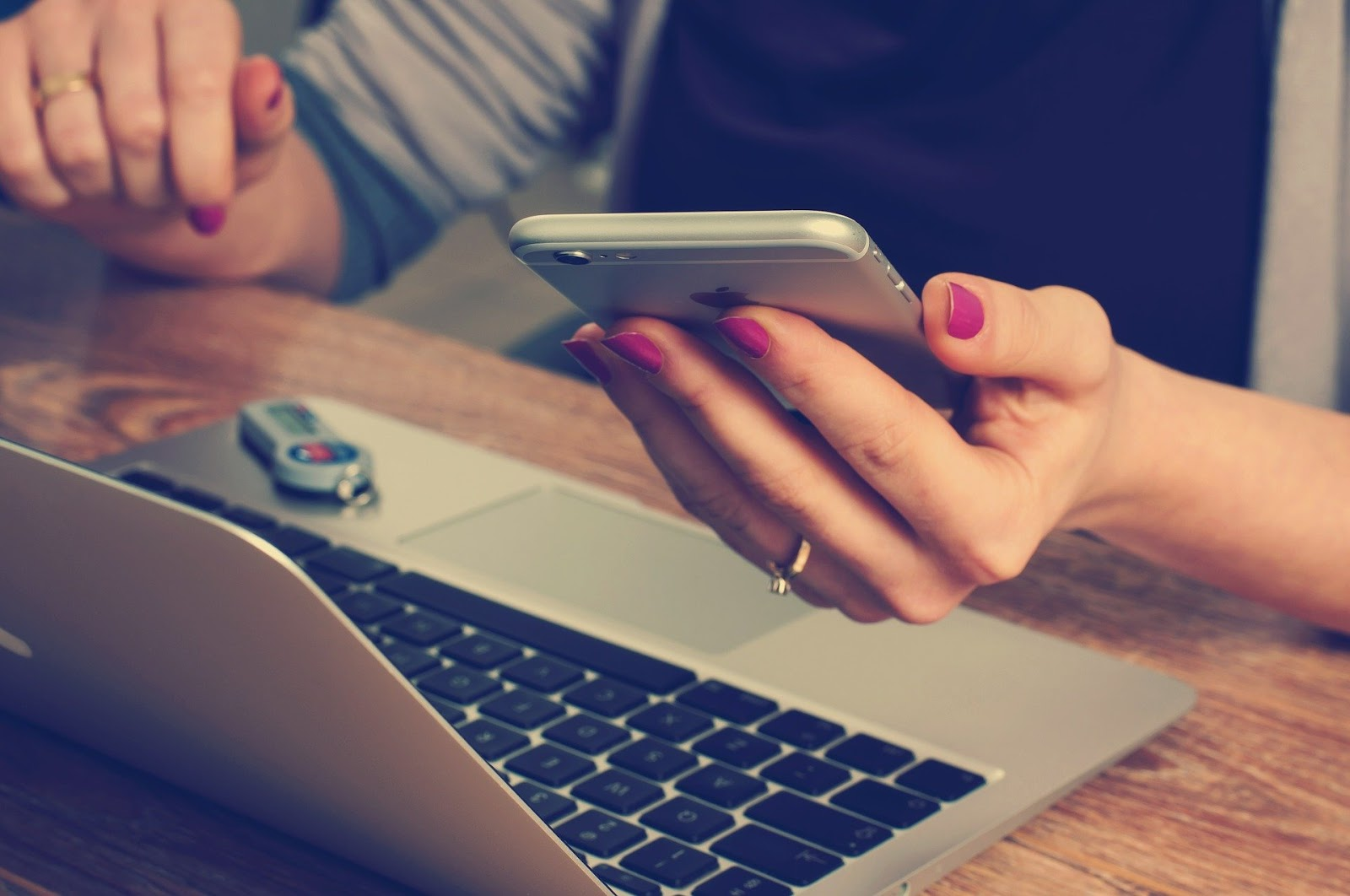 ways to increase your CTR on search engines - image of a woman operating her laptop and phone